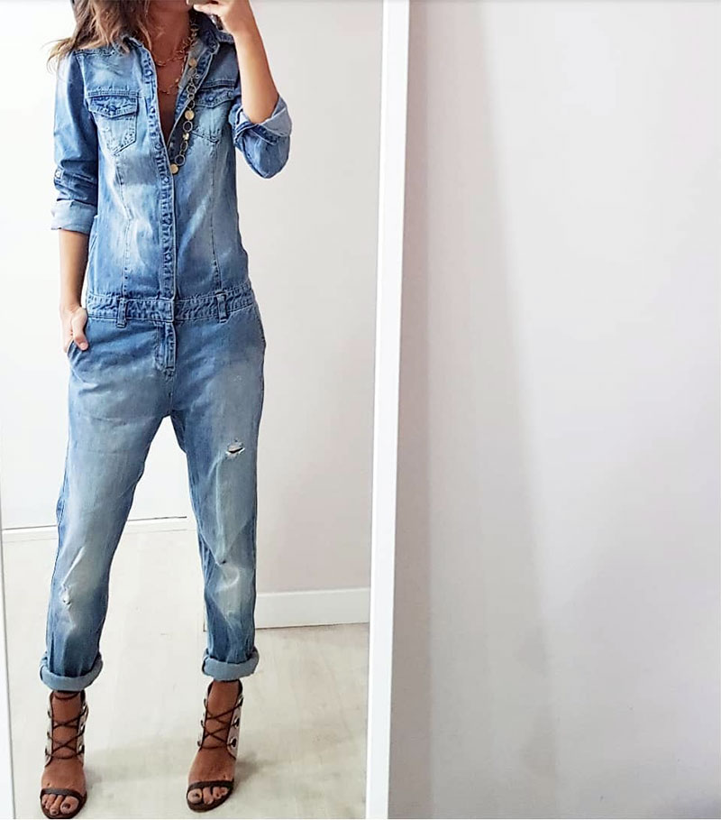 Woman in denim jumpsuit