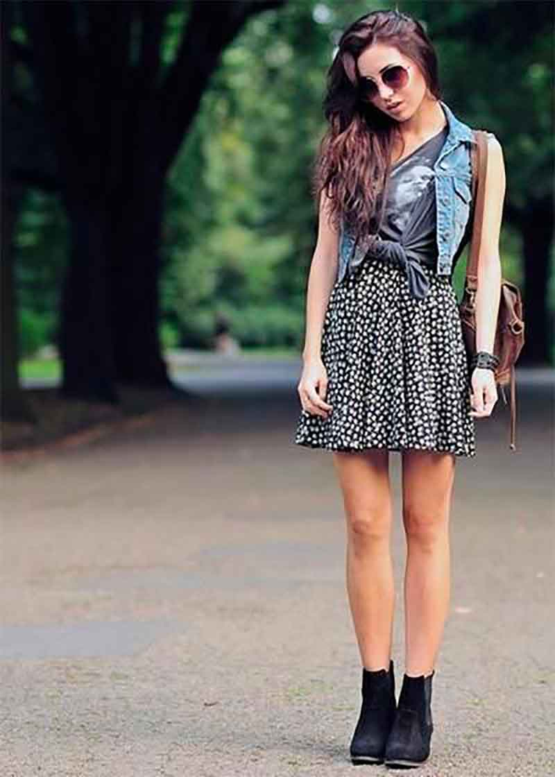 Layer your vest over a graphic tee and printed skirt