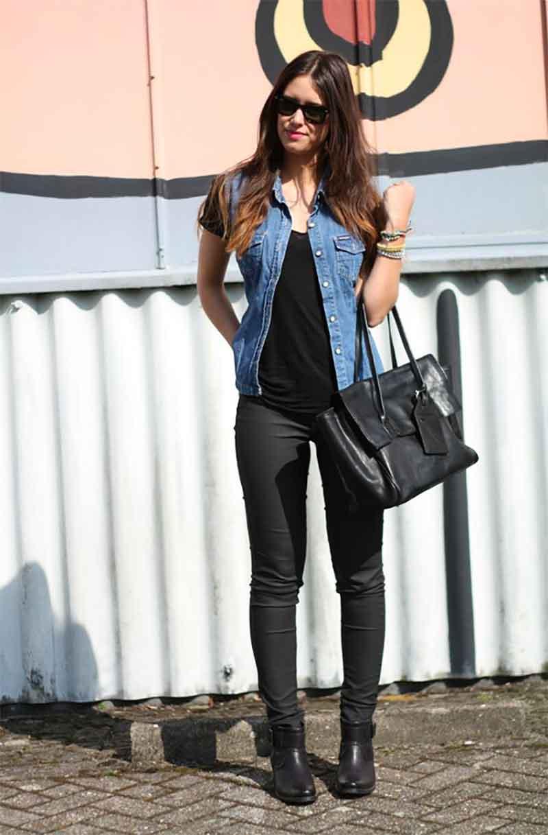 all-black ensemble with a light denim vest
