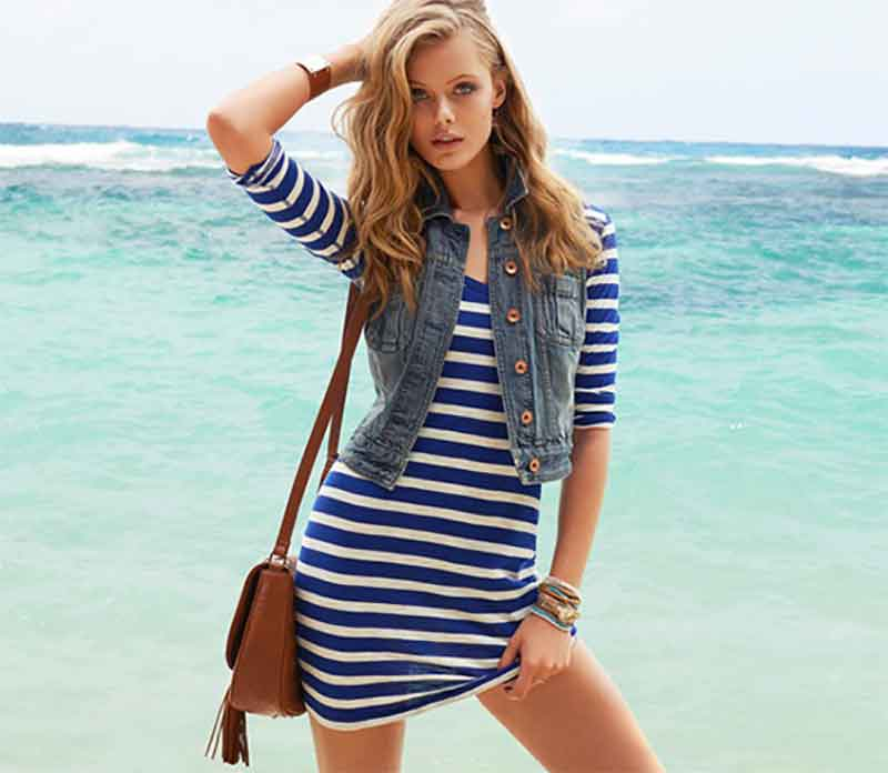 wear your vest over a striped dress