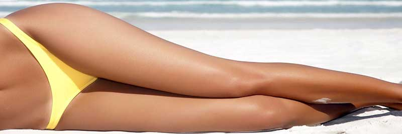 Legs after using a laser hair treatment at home.