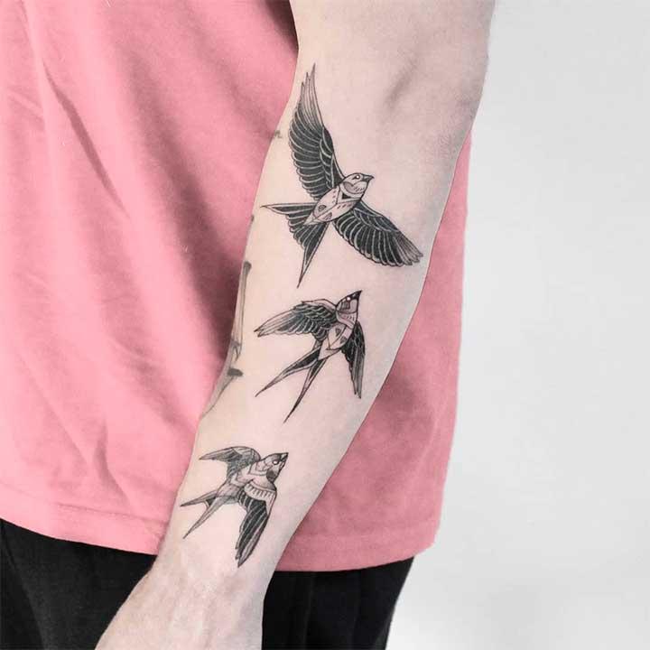 Flying birds tattoo on wrist