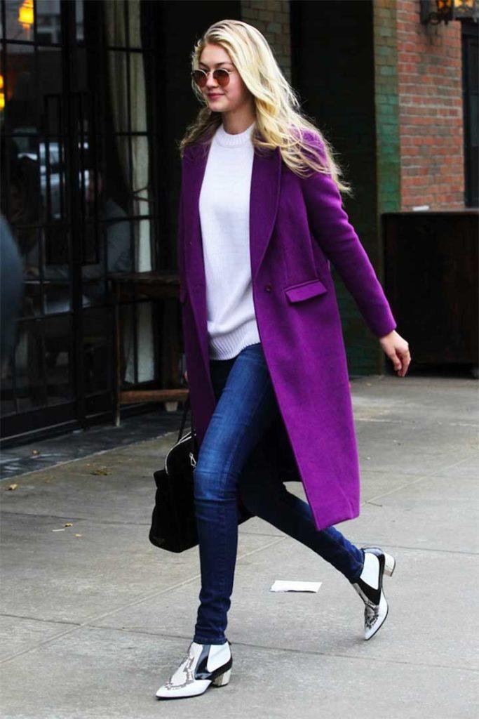 Gigi Hadid seen in a long purple coat in New York City