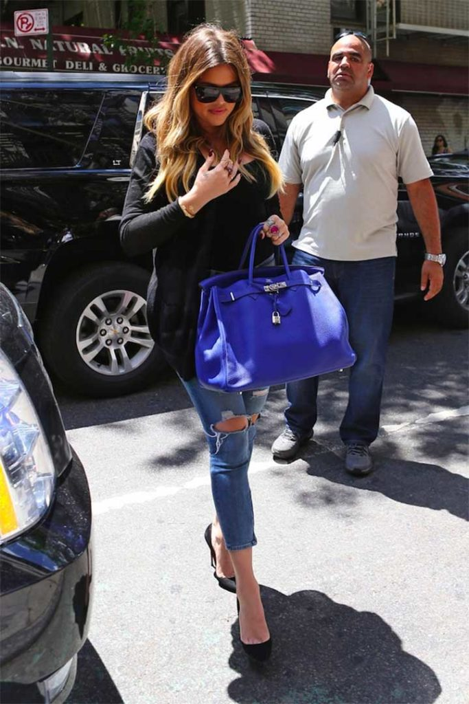 Kim, Kourtney and Khloe Kardashian grab lunch together in Soho after scouting locations for a Dash Store