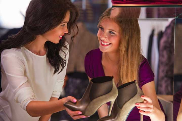 ladies shopping for boots