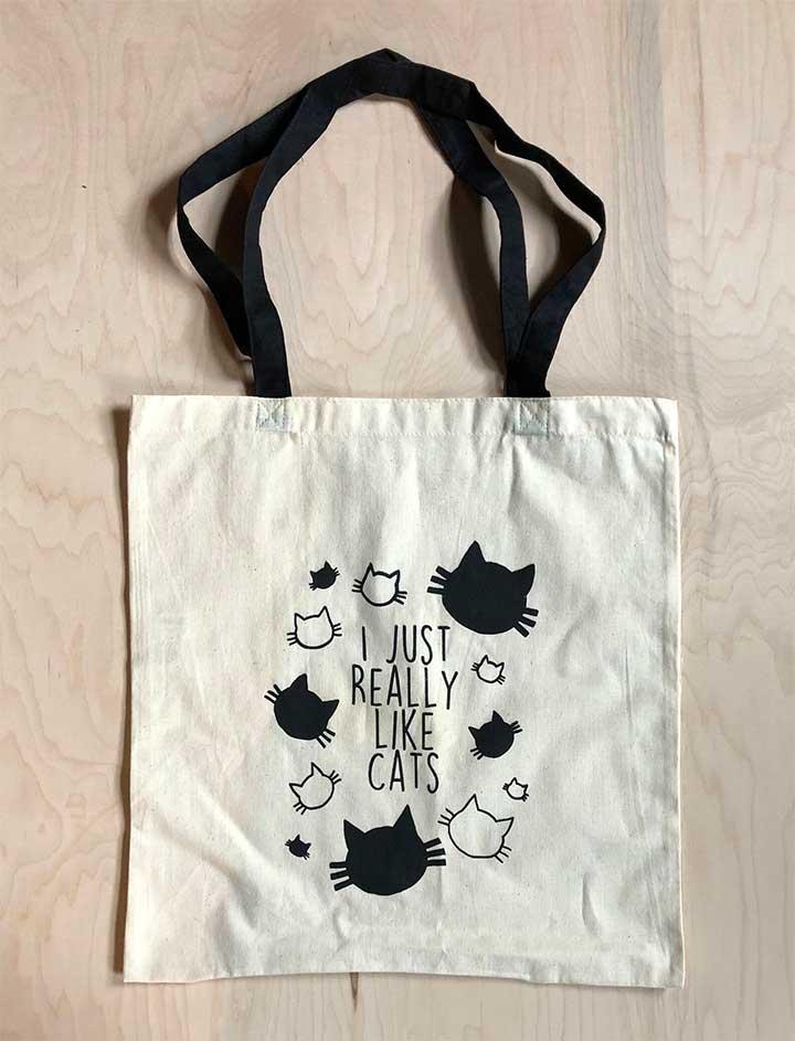 Black Cat Quote Tote Bag