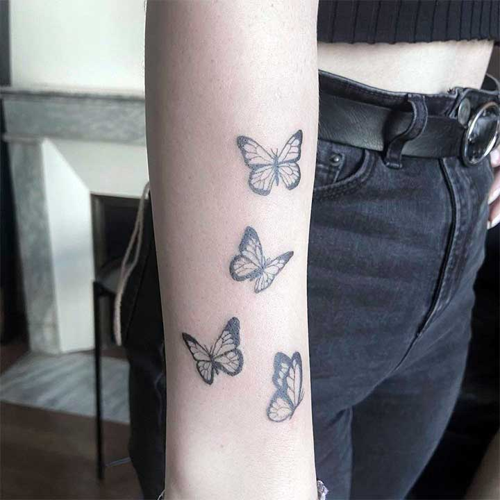 butterfly tattoo on wrist with name
