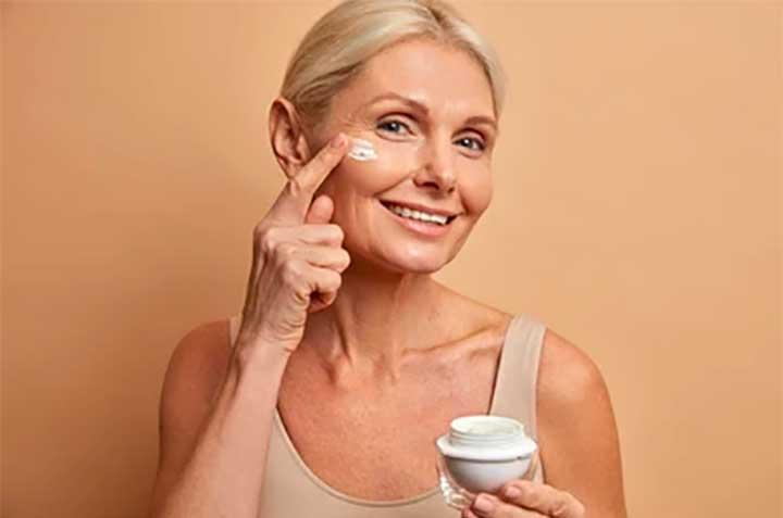 Woman with jar of cream