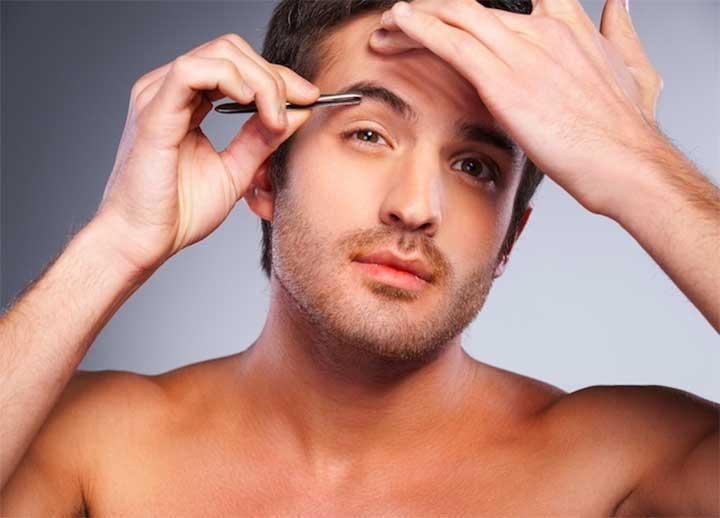 man grooming his eyebrows