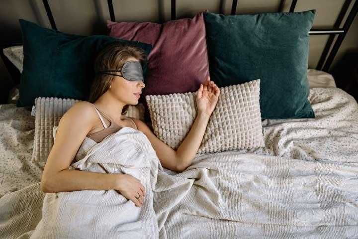 A Woman Wearing a Sleep Mask While Sleeping