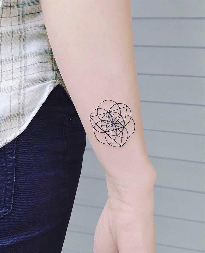 small triangle tattoo